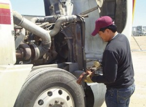 Checking the motor oil in a big rig