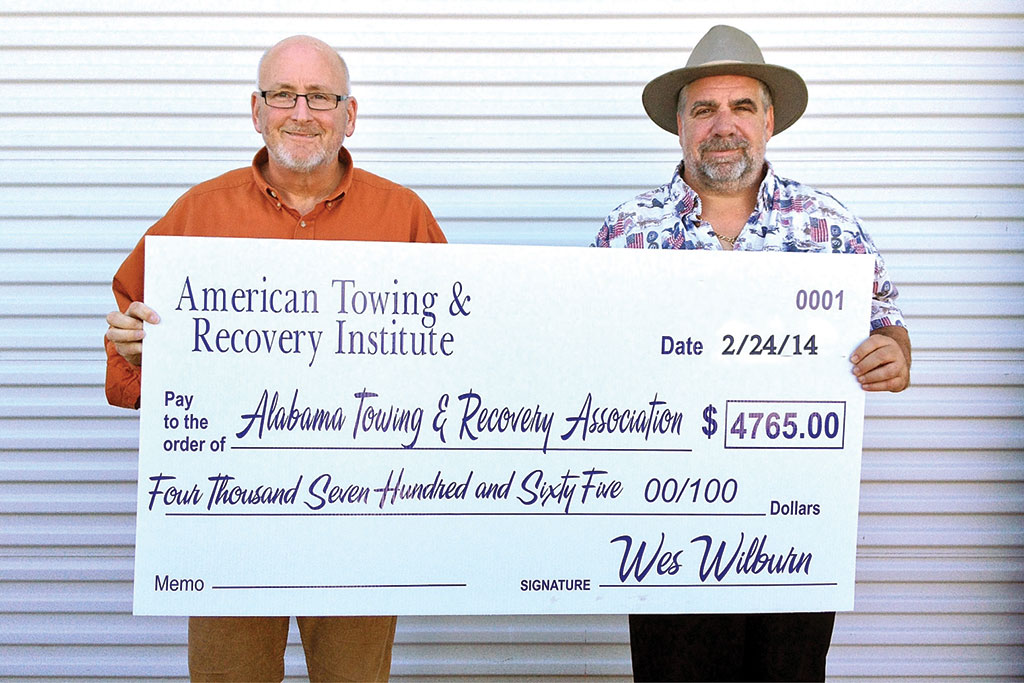 American Towing and Recovery Institute presented a check to Alabama Towing & Recovery Association